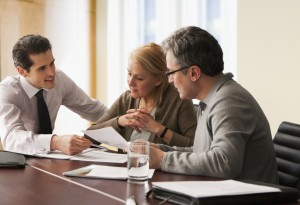 Advisor going over papers with couple